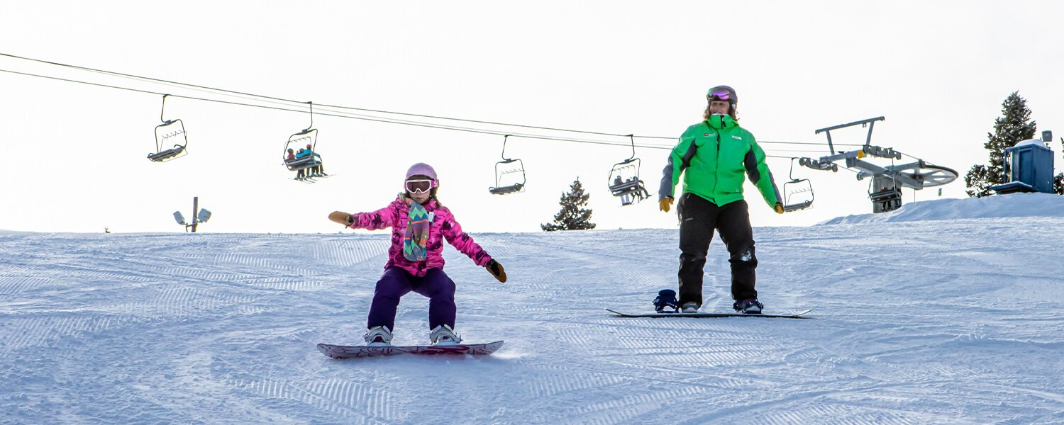 Snowboard Lesson with student and instructor