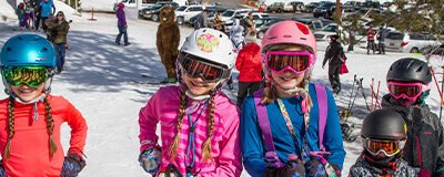 Happy kid skiers