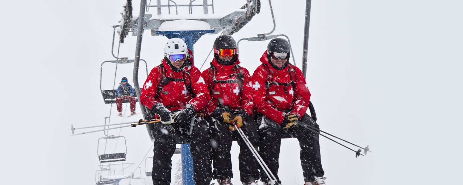 Three Ski Patrol team members on a on chairlift
