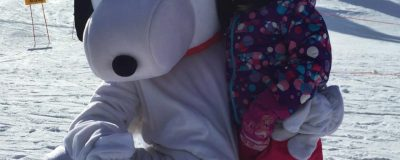 Snoopy character and child